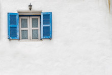 Old Blue Window And White Wall