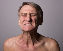 Spasm,senior Man Showing Pain Concept