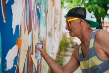 Senior Hipster Man Painting A ...