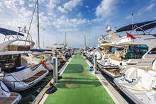 Yachts Lined Up Along Pontoon At Marina Of Puerto Portals