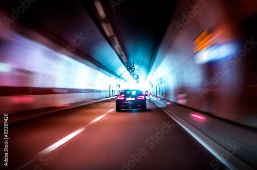 fototapeta na lodówkę Luxurious car rides fast in a dark tunnel