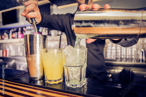 Fotografie, Obraz  Pouring alcohol.