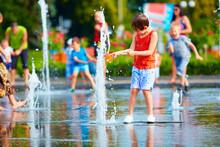 Excited Boy Having Fun Between Water Splashes, In Fountain. Summ