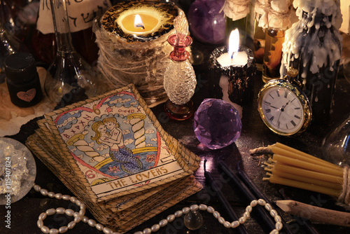 The tarot cards with crystal, candles and magic objects