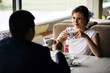 Wedding couple indoors drinking coffee. Beautiful model girl in white dress. Man in suit. Beauty bride with groom. Female and male portrait. Cute lady and handsome guy