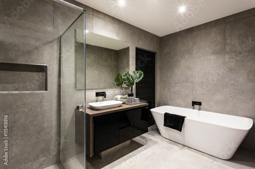 Foto  Modern bathroom with a shower area and bathtub