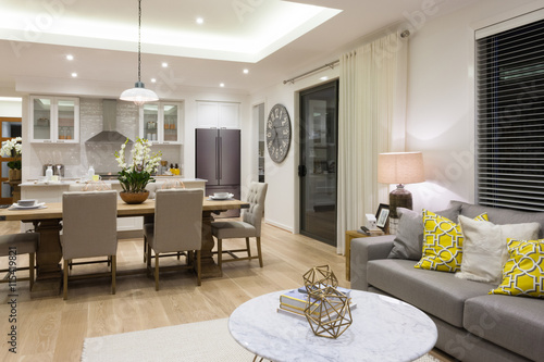 Luxury living room beside a dining room and the kitchen Poster