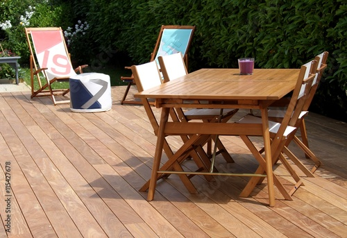 terrasse en bois exotique et salon de jardin - Buy this stock photo ...