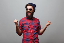 Happy Hipster Man With Beard Exults