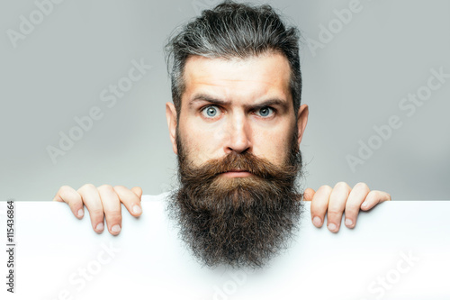 bearded surprised man with paper Fotobehang