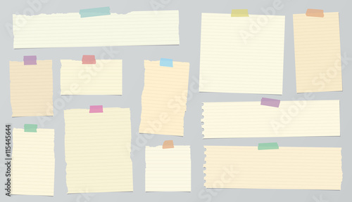 Fotografía  Pieces of light brown ruled torn note paper with colorful adhesive, sticky tape