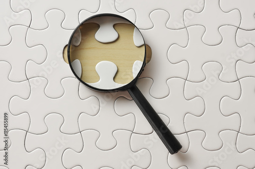 Magnifying Glass On Missing Puzzle Canvas