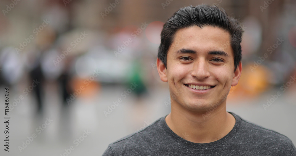 Fototapety, obrazy: Young latino man in city face portrait smile
