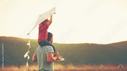 Fotografie, Obraz  happy family father and child on meadow with a kite in summer