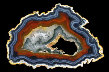 Obraz na Szkle Kamienie A cross section of the agate stone with geode on a black background. Origin: Brazil.