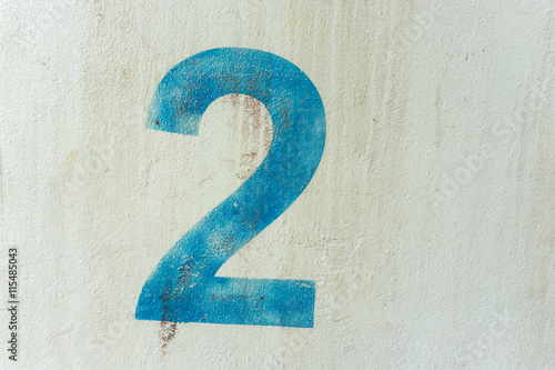 Fototapeta the number 2 on the dirty white wall obraz
