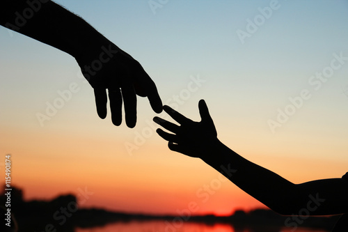 silhouette parent and child hands Canvas Print