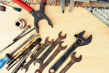 Old Rusty Tools On A Wooden Background
