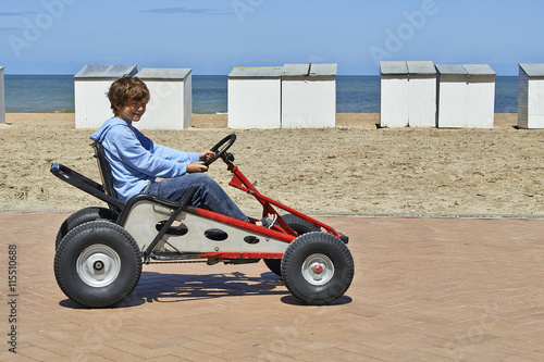 Young boy driving a Quadricycle - Buy this stock photo and