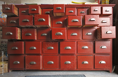 Wooden cabinet with opened drawers