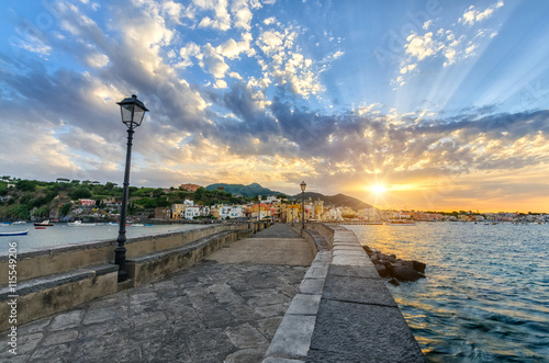 Fotomural  Evening cityscape of Ischia, Italy