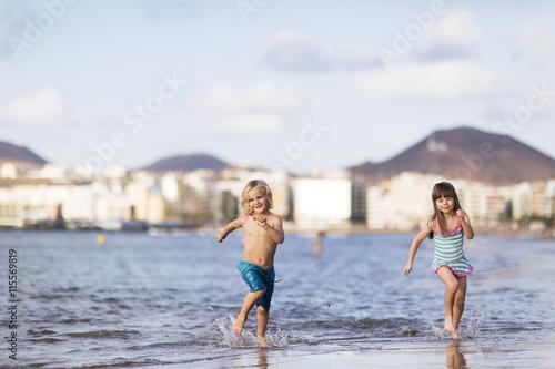 Spain, Gran Canaria, Las Palmas, Children (4-5) running on beach