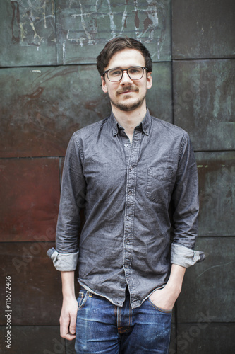 Sweden, Young man against metal wall