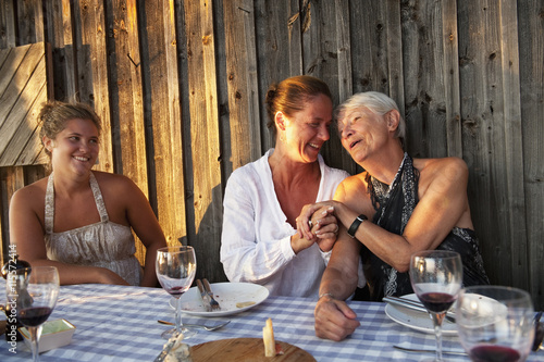 Sweden, Stockholm, Sodermanland, Dalaro, Grandmother, Mother and daughter at table