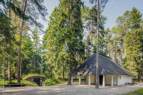 Sweden, Sodermanland, Stockholm, Gamla Enskede, Skogskyrkogarden, House among green trees under clear sky