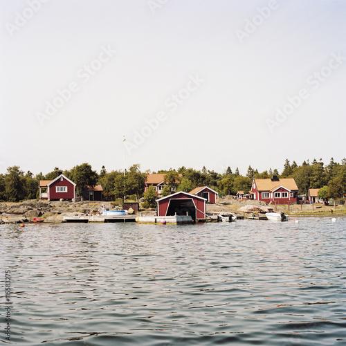 Sweden, Uppland, Stockholm Archipelago, Village harbor and waterfront houses