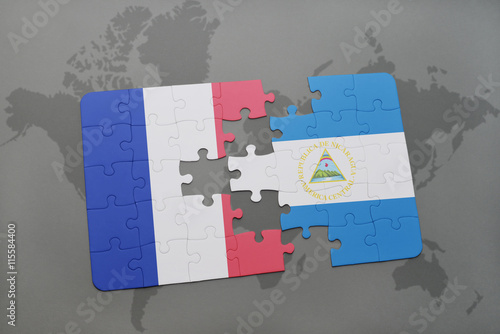 puzzle with the national flag of france and nicaragua on a world map ...