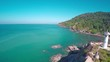 Flying over the lighthouse on the south coast of Koh Lanta island, Krabi, Thailand, 4k