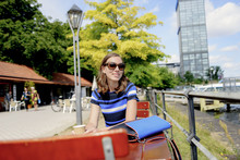 Germany, Berlin, Treptower Park, Woman At Cafe Table