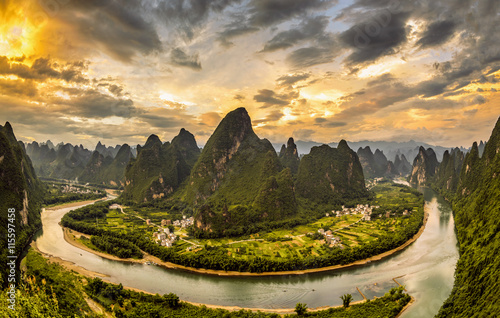 Photo Stands Guilin Xianggong hill landscape of Guilin, Li River and Karst mountains. Xingping, Yangshuo County, Guangxi Province, China.