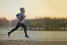 Young Athletic Man Running At ...
