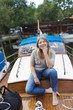 Sweden, Stockholm, Sodermalm, Portrait of woman sitting on boat