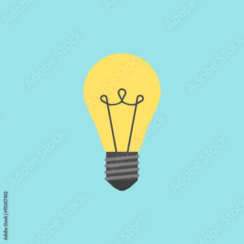 Photo Yellow lightbulb on blue