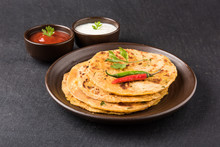 Traditional Indian Bread-Aloo Paratha ,potato Stuffed Bread. Served With Tomato Ketchup Or Sauce And Curd
