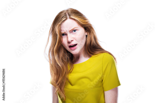 Portrait of interrogative and serious young girl isolated on whi Fototapeta