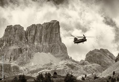 fototapeta na szkło Rescue Helicoper in action. Italian dolomites
