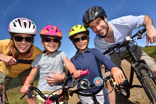 Portrait of happy family on a biking day