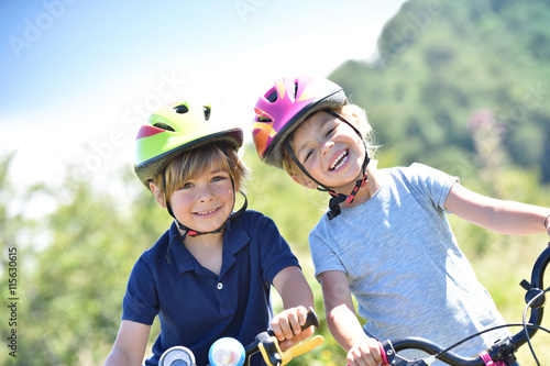 Portrait of cheerful kids riding bikes