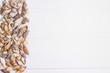 Sea shells on white wooden background