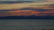Sea and outlines of mountains at the sunset