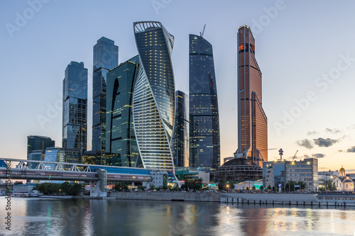 Poster Abou Dabi Moscow International Business Center on a sunset.