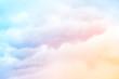 Leinwandbild Motiv Rainbow Clouds.  A soft cloud background with a pastel colored orange to blue gradient.