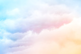 Fototapeta Tęcza - Rainbow Clouds.  A soft cloud background with a pastel colored orange to blue gradient.