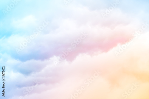Foto op Canvas Hemel Rainbow Clouds. A soft cloud background with a pastel colored orange to blue gradient.
