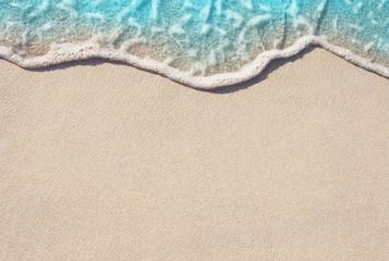 Soft ocean wave on the sandy beach, background.