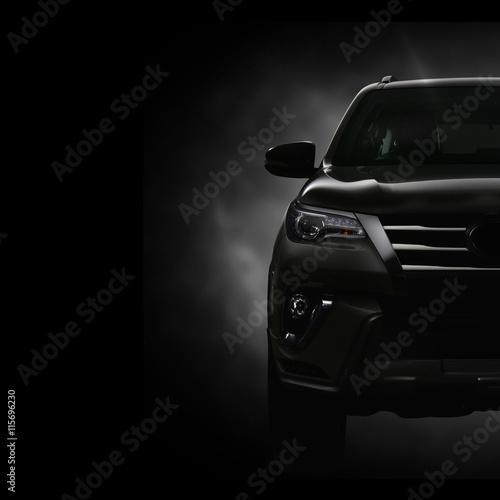 Obraz na plátně  SUV Car on Black Background with Smoke Effect